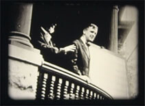 Image of Andrew Taylor Still on a balcony with student