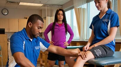 Image of ATSU athletic trainer examining fellow student patient