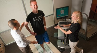 Image of ATSU kinesiology professor demonstrating ankle supination for kinesiology student