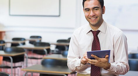 Photo of man in classroom with e-tablet representing MS-SHE program