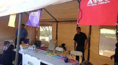 ATSU Physical Therapy Department information booth set up at an outdoor event.