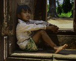 Orphan at a temple in Cambodia