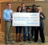 Students present the check to Susan Dublin, regional coordinator, Food Bank for Central and Northeast Missouri.