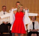 Kate Avery, D1, receives her white coat from Christopher Halliday, DDS, MPH, dean.