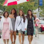 Rain drizzles on Elizabeth Desamero, D1, and her family at the White Coat Ceremony, held Sept. 28.