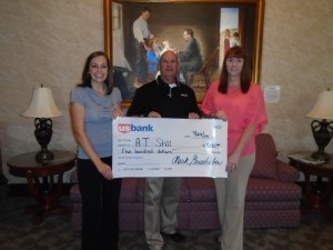 Wayne Blackman (center) from US Bank in Kirksville presents a check to ATSU's Brooke Kelsey (left) and Cheri Coin (right)