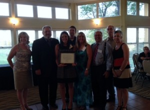 Dr. Mia Pendergrass, center, is presented with the Outstanding Student in Audiology Award.
