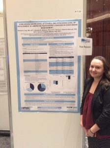 Melissa Kay next to her concussion conference poster