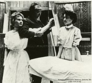 Dr. Still demonstrates osteopathic manipulation on Augusta Teuckes, an ASO student nurse. Museum of Osteopathic Medicine [1992.1535.02.03]