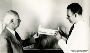 President Laughlin and Dr. Denslow examine medical instruments. Museum of Osteopathic Medicine [1984.961.30]