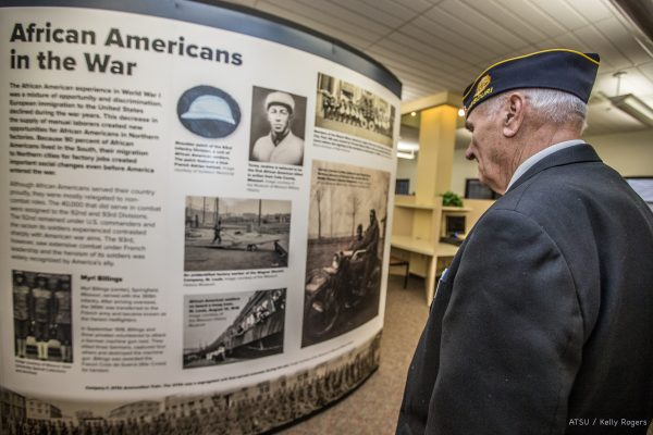 Older gentleman views part of the WWI exhibit at the Missouri library