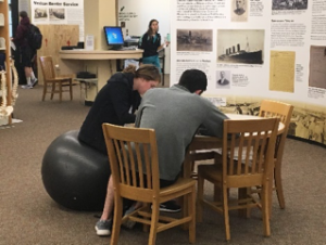 Image of student using a new stability ball in the library