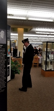 Man viewing the WWI exhibit at the Missouri library