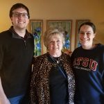 ATSU-KCOM students Adam Russell and Kristina Grant pose for a picture with Kirksville resident Janet Snyder.