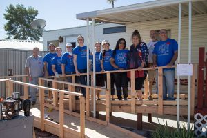 ATSU volunteers and Christine Vanek pose for a picture on the accessibility ramp that was built.