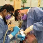Two ATSU-MOSDOH students provide dental care to a community member in Dexter, Missouri.