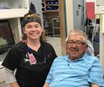 Dr. Nieto poses for a picture next to a patient.