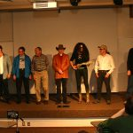 professors standing in costume for air guitar competition