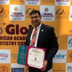 Dr. Haribabu standing with certification award