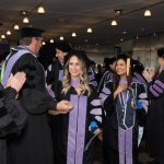 ATSU-ASDOH graduates greet members of ATSU faculty and staff after their commencement ceremony