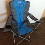 a camping-style chair with the ATSU logo