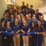 Students and faculty participate in a ribbon cutting for the new OT PT Center at ATSU