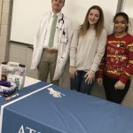 ATSU Kirksville Family Medicine resident Jason Buchan, DO, poses with William Matthew Middle School students Mabry Elmore and Gianna Smith