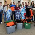 Volunteers with the A.T. Still University Rotaract Club pose with blankets