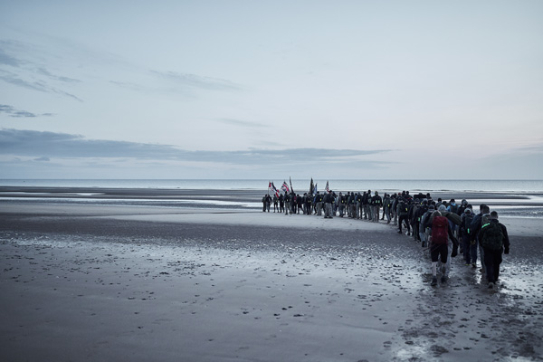 Ruck marching participants walking in a line on beach