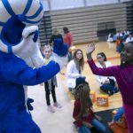 Bucky greets a Kirksville Primary School student
