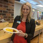 Kayla Black, DPT, PT, CCS, helping serve breakfast.