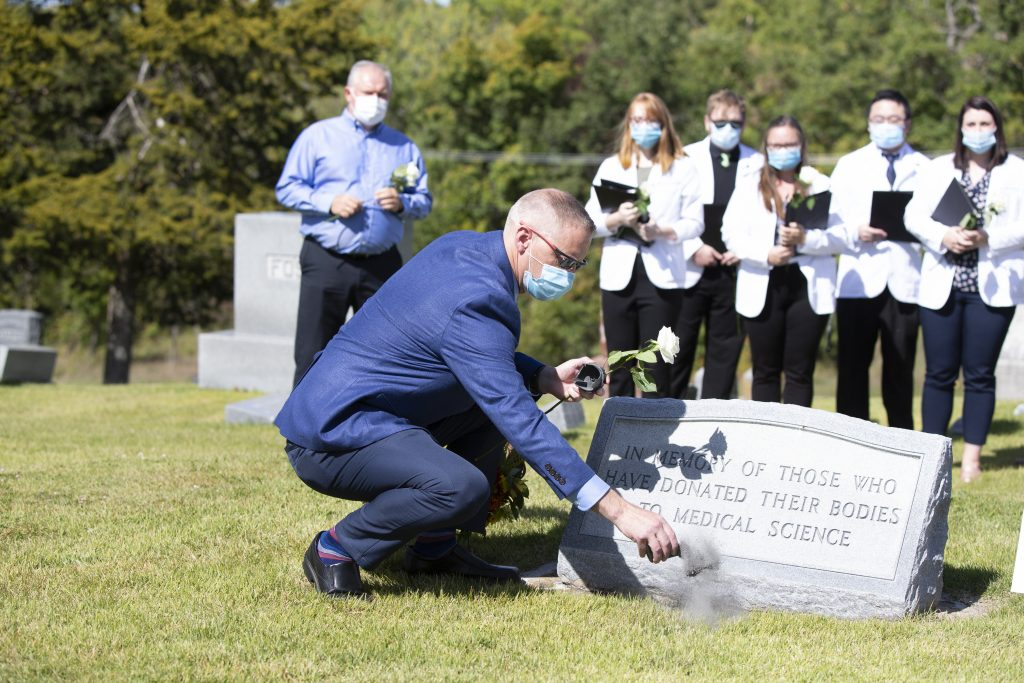 Jeremy Houser, PhD, scatters ashes