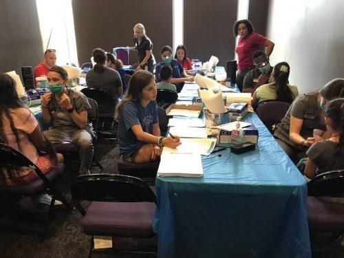 ATSU-ASODH students providing dental care at the Grand Canyon University Back to School clothing drive