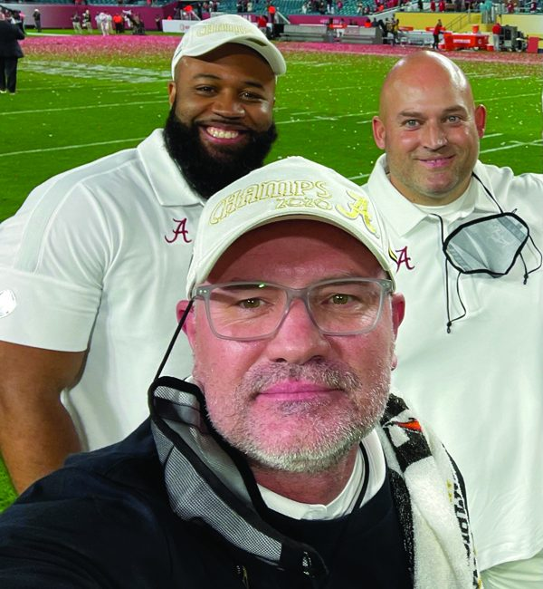 From left, Paul Constantine, Dr. Matt Rhea, and David Ballou take a selfie after Alabama football's win in the 2020 NCAA football national championship game.