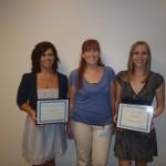 Melanie Kropp (left) and Jennifer Apel (right) received their awards from SAA president Krystal Hulleman (center)