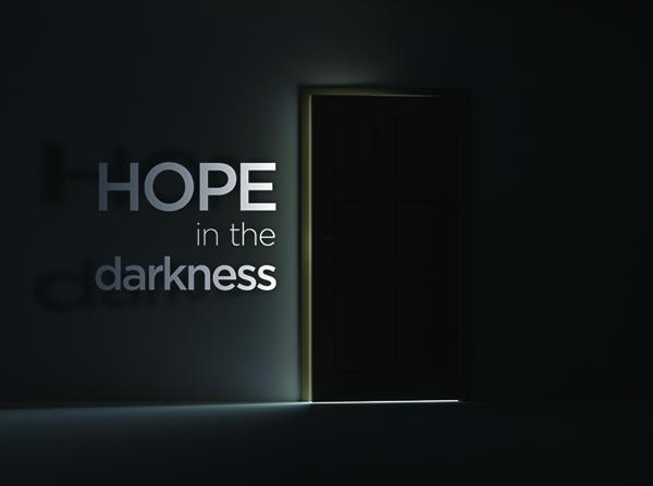 dark room with light coming through door opening