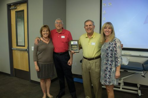 Dr. Dabrowski, two representatives from the HLAA and Dr. Parent-Buck pose with the plaque given to ATSU for the funds raised during the Arizona Walk 4 Hearing