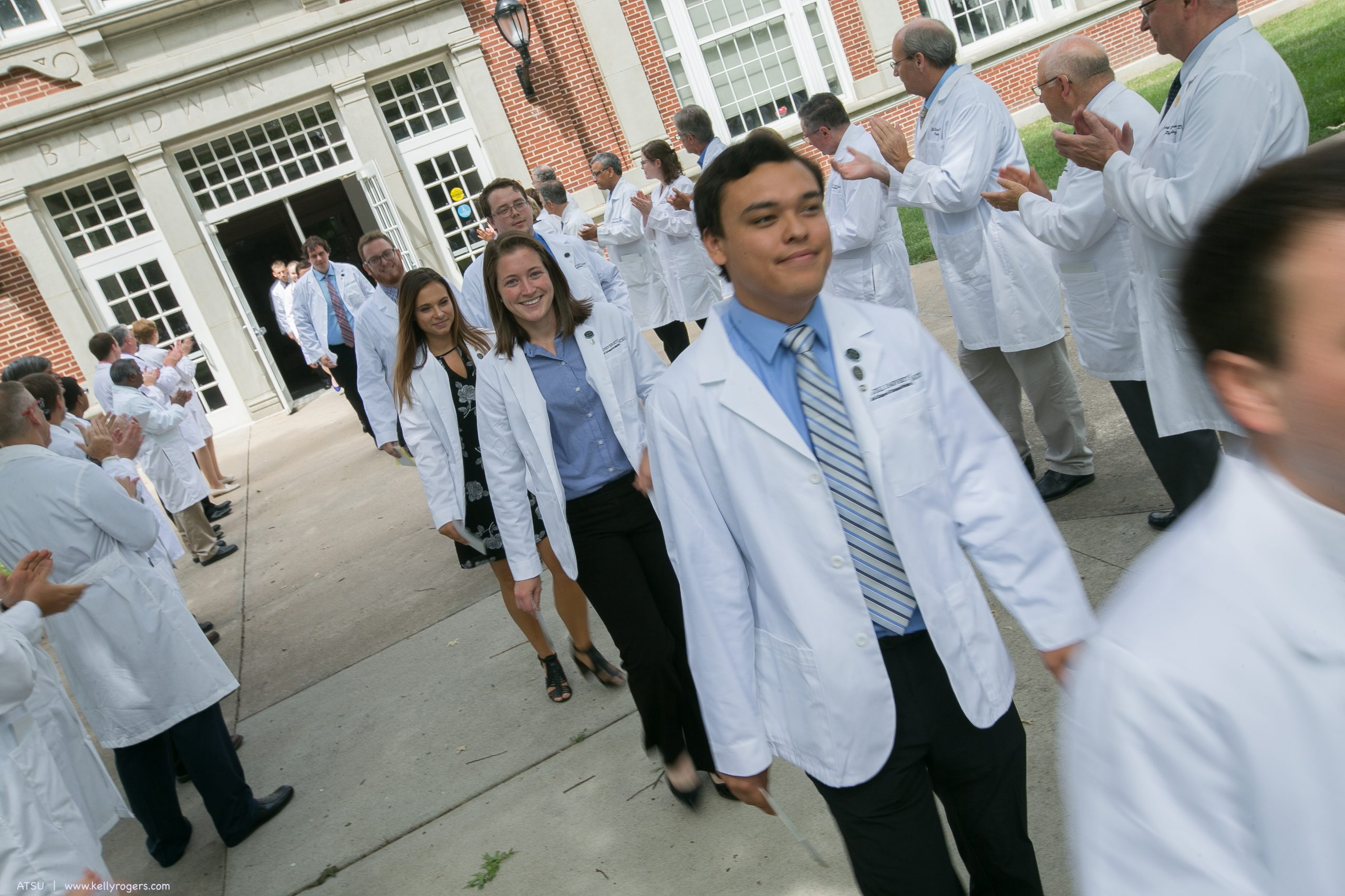 Students walking from ceremony