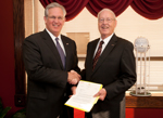 Missouri Governor Jay Nixon presents a letter of endorsement to ATSU President Jack Magruder.