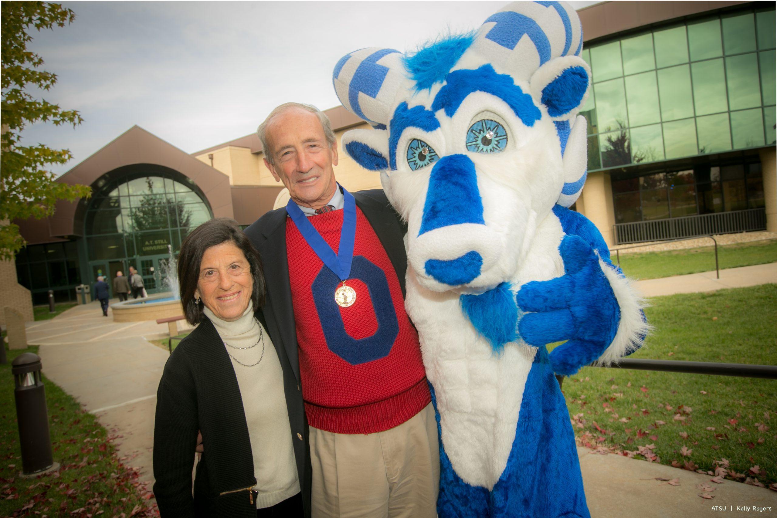 man & woman posing with Bucky mascot