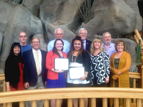 Jocelyn Caven and Tashia Gadlin pose with members of the audiology faculty after receiving their scholarships