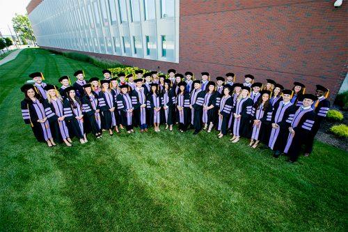 The first set of graduates from ATSU-CODA in their graduation regalia