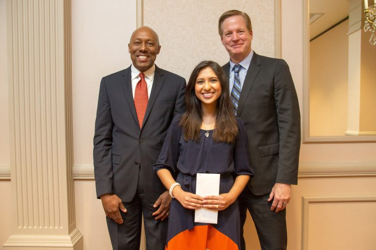 ATSU-MOSDOH Dean Dwight McLeod, Dr. Phelps, and Pardeep Kaur Gill, DMD, '17, celebrate the School's inaugural graduating class at an awards banquet on May 16.